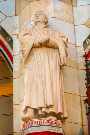 Martin Luther Statue All Saints Castle Castle Church Schlosskirche Lutherstadt Wittenberg Germany. Where Luther posted 95 thesis 1517 starting Protestant Reformation.