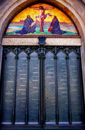 95 Theses Door Luther Jesus Crucifixion Mosaic Castle Church Schlosskirche Lutherstadt Wittenberg Germany. Door where Luther posted 95 thesis 1517 starting Protestant Reformation. Mosaic and door built 1858
