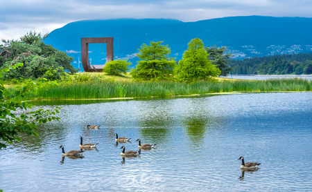 Pond Canadian Geese Gate To The Passage Northwest Square Statue Vanier Park Vancouver British Columbia Canada Pacific Northwest.  Gate sculpture by Alan Chung Hing in 1980 Editöryel