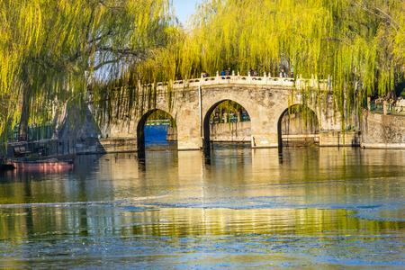 Bridge Green Willows Jade Flower Island Beijing China Beihai public park created  1000AD.
