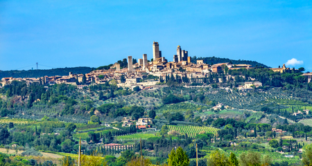 Medieval Stone Tower sAncient Buildings Town San Gimignano Tuscany Italy.  Vineyards Fields Hill Town