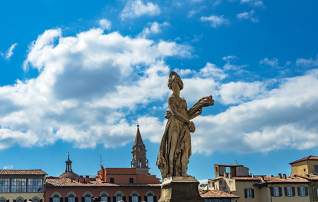 Summer Statue Ponte Bridge Santa Trinita Arno River Florence Italy. Bridge 1300s Statue by Giovanni Caccini in 1608. 免版税图像