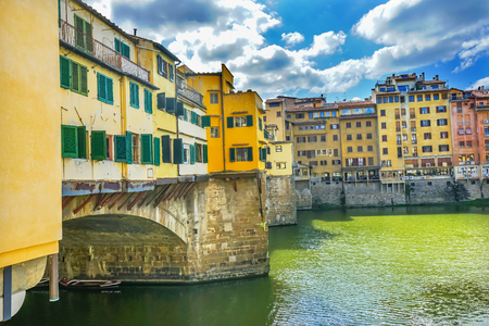 Ponte Vecchio Bridge Reflections Arno River Florence Tuscany Italy. Bridge originally built in Roman times, rebuilt in 1345.
