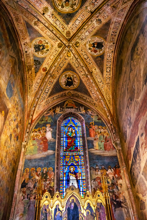Altarpiece Redeemer Jesus Christ, Frescos, statined glass window, Strozzi Chapel Santa Maria Novella Church Florence Italy. Altarpiece created Andrea Orcagna 1357 First Church in Florence founded 1357