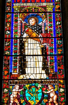 Saint Thomas Aquinas Stained Glass Chapel Santa Maria Novella Church Florence Italy. Church founded 1357. Aquinas determined reason in God. Editorial