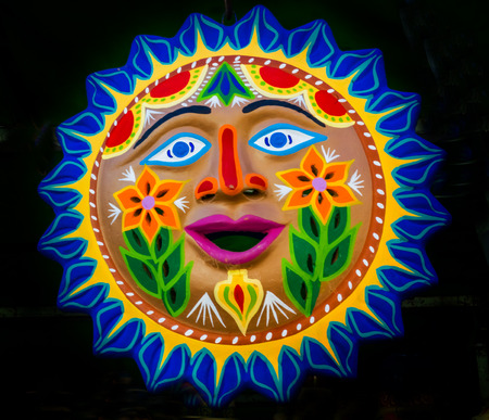 Colorful Mexican Ceramic Sun Face Handicraft Blue Turquoise Yellow Green Oaxaca Juarez Mexico.
