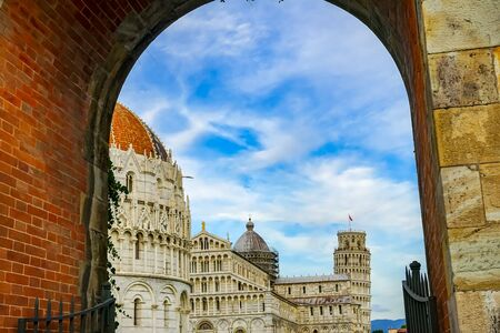 City Gate Piazza del Miracoli Leaning Tower Baptistery of Saint John Cathedral Pisa Tuscany Italy. Completed in 1300s 版權商用圖片