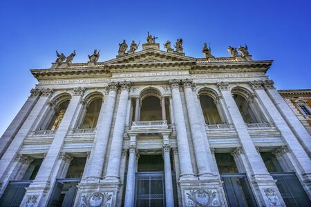 Facade Front Entrance Statues Saint John Lateran Papal Cathedral Church Rome Italy. One of 4 Papal basilicas, Oldest Papal Church built 324 by Emperor Constantine, built in honor of John Baptist John the Evangelist
