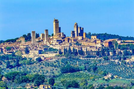 Medieval Stone Tower ancient Buildings Town San Gimignano Tuscany Italy.  Vineyards Fields Hill Town Archivio Fotografico
