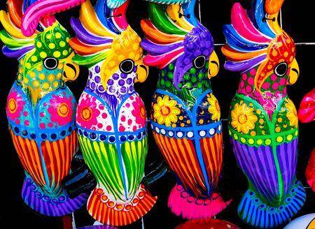 Colorful Blue Pink Yellow Ceramic Parrots Oaxaca Mexico.  Many ceramic factories throughout the country