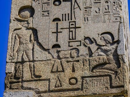 . Ancient Egyptian Figures Hieroglyphics Obelisk Piazza Popolo Rome Italy.  Second Oldest Obelisk in Rome 10 BC.