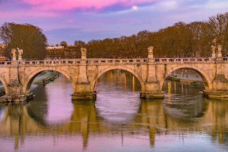 Moon Pink Sunset Bernini Angels Ponte Bridge Saint Angelo Tiber River Reflection Rome Italy. Bridge made in 1600s.