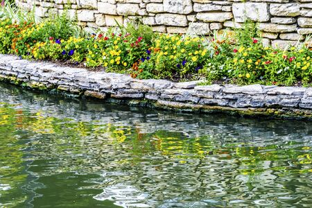 Colorful Flowers Reflection River Walk San Antonio Texas. 15 Mile River Walk created in the 1960s to deal with flood problem.