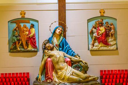 Pieta Mary Jesus Statue Saint Mary's Catholic Church San Antonio Texas. Built in 1857, Stained Glass from 1914