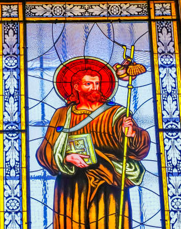 Colorful Saint James Stained Glass Basilica Cathedral Puebla Mexico. Built in 15 to 1600s. Christ disciple, patron saint of Spain, symbol clamshells.