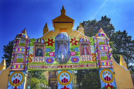 Colorful Christmas Gate Church of Templo de Santa Maria Tonantzinta Cholula Puebla Mexico. Words on Gate say Happy Christmas and New Year,