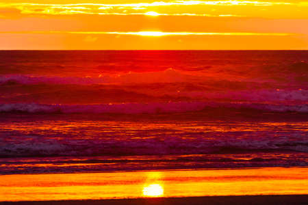 Colorful Blue Red Orange Sunset Pacific Ocean Coastline Canon Beach Clatsap County Oregon.  Amazing Sunsets at Canon Beach