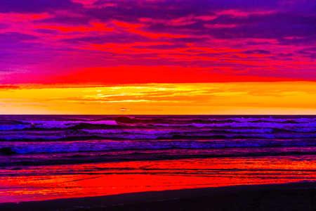 Colorful Blue Red Orange Sunset Abstract Birds Pacific Ocean Coastline Canon Beach Clatsap County Oregon. Amazing Sunsets at Canon Beach