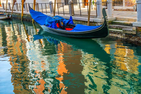 Colorful Condola Small Canal Reflections Venice Italy