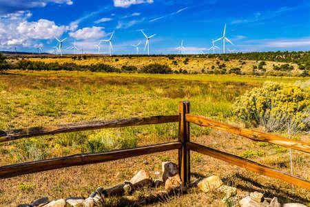 Windmills Large Wind Turbines Farm Fence Sustainable Power Project Monticello Utah.