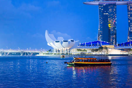 Night Photo of Singapore Marina Bay Sands hotel and River, Singapore, April 14 2018 Editorial
