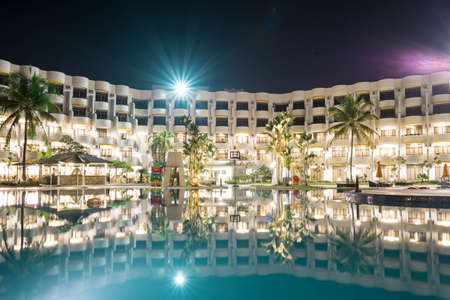 Landscape view of a Hotel resort during night with slow shutter smooth swimming water and nice starry light Editorial