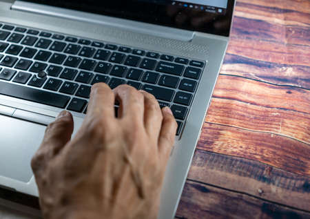 Laptop with a hand while typing or encoding. Business concept, office concept, work from home concepts