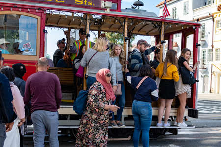 powell and Hyde Cable Car train with some tourists near Beach street, San Francisco, California, USA, March 30, 2020