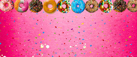 colorful donut with sprinkle on pink background. Background image with copy space