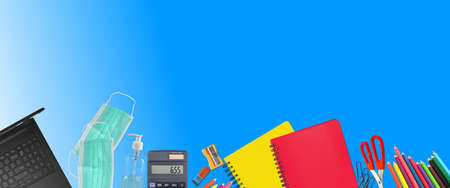 School supplies and covid 19 prevention items. Bottom border on a blue background paper. Back to school during pandemic concept with copy space.