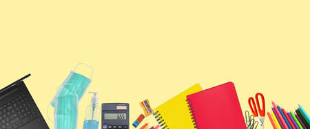 School supplies and covid 19 prevention items. Bottom border on a yellow soft background. Back to school during pandemic concept with copy space.