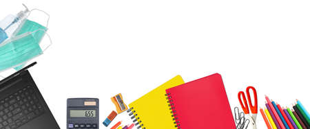 School supplies and covid 19 prevention items. Bottom border on a white background. Back to school during pandemic concept with copy space. Stock Photo