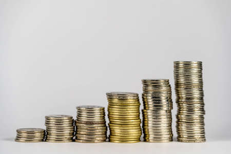 Place the coins in a line from low to high. Manage your savings to grow by investing in stocks or funds. Idea of growing money.