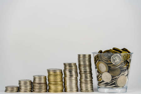 money saving, business financial growth, economy budget and investment concept. golden coins in jar and coin stack growth up on white background.