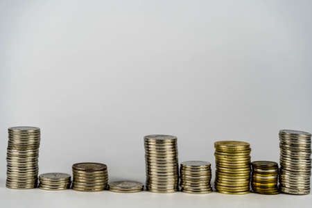 stacking of coins on top of the coin pile on the highest row. Placing coins in a row from low to high is comparable to saving money to grow more. Money saving ideas for investing in funds.