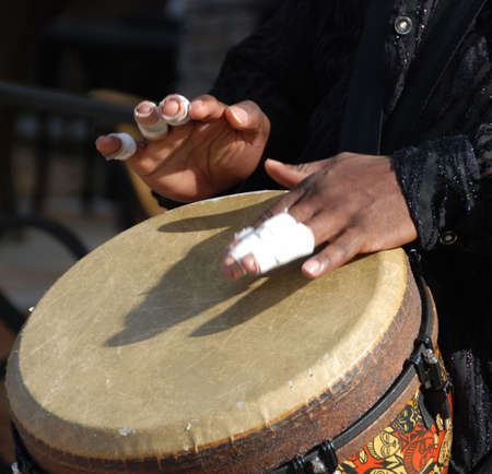percussionist: Bongo drum, Bandaged finger