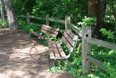 split rail: Park benches along split rail fence Stock Photo