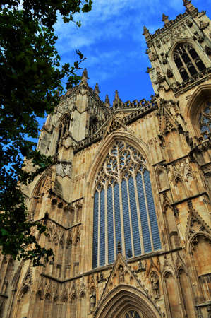 humilde: Ancient York Cathedral Tower, Cloudy Blue Sky, Sandstone and Windows in England