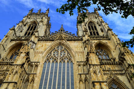 fifth avenue: Ancient York Cathedral Tower, Cloudy Blue Sky, Sandstone and Windows in England