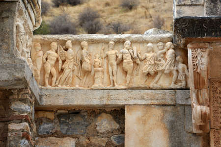friezes: image show a copy piece of a human figure,probably friezes depicting the story of the foundation of Ephesus, at Temple of Hadrian, ancient city of Ephesus, Turkey Stock Photo