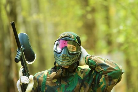 paintball: girl in camouflage after paint ball game