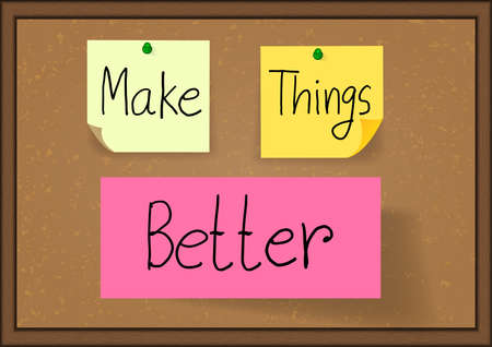 message board: Hand drawn the phrase make things better on notes are pinned to a cork message board with wood frame,