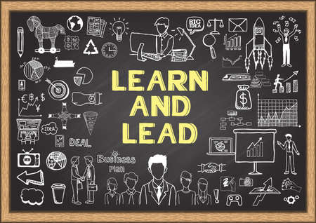 Business doodles about learn and lead on chalkboard.