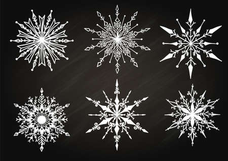 Hand drawn snowflakes on chalkboard for design element.