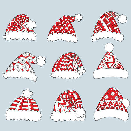Set of red santa hats isolated on white background.