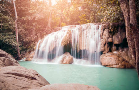 Erawan waterfall in forest. Southeast Asia, Kanchanaburi, Thailand in February 2018 Stock Photo