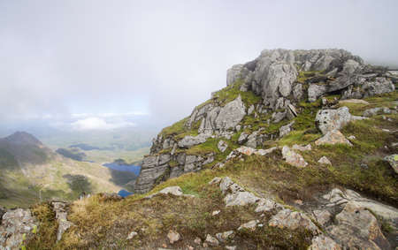 North Wales, United Kingdom - July 2018 : Tracks on the mountain rocks in Snowdonia National Park, View from the almost reach the highest point. Redactioneel