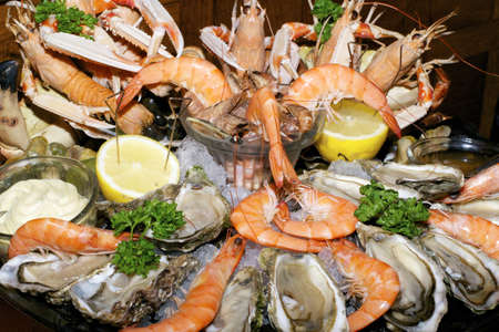 assorted prepared seafood with lemon and mayonnaise photo