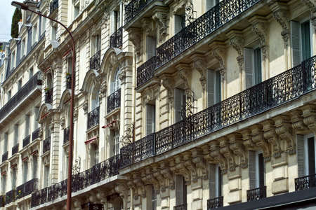 Traditional facade and balconys of parisian architecture photo