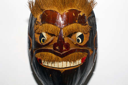 witchery: photography of a wooden african mask isolated on white Stock Photo